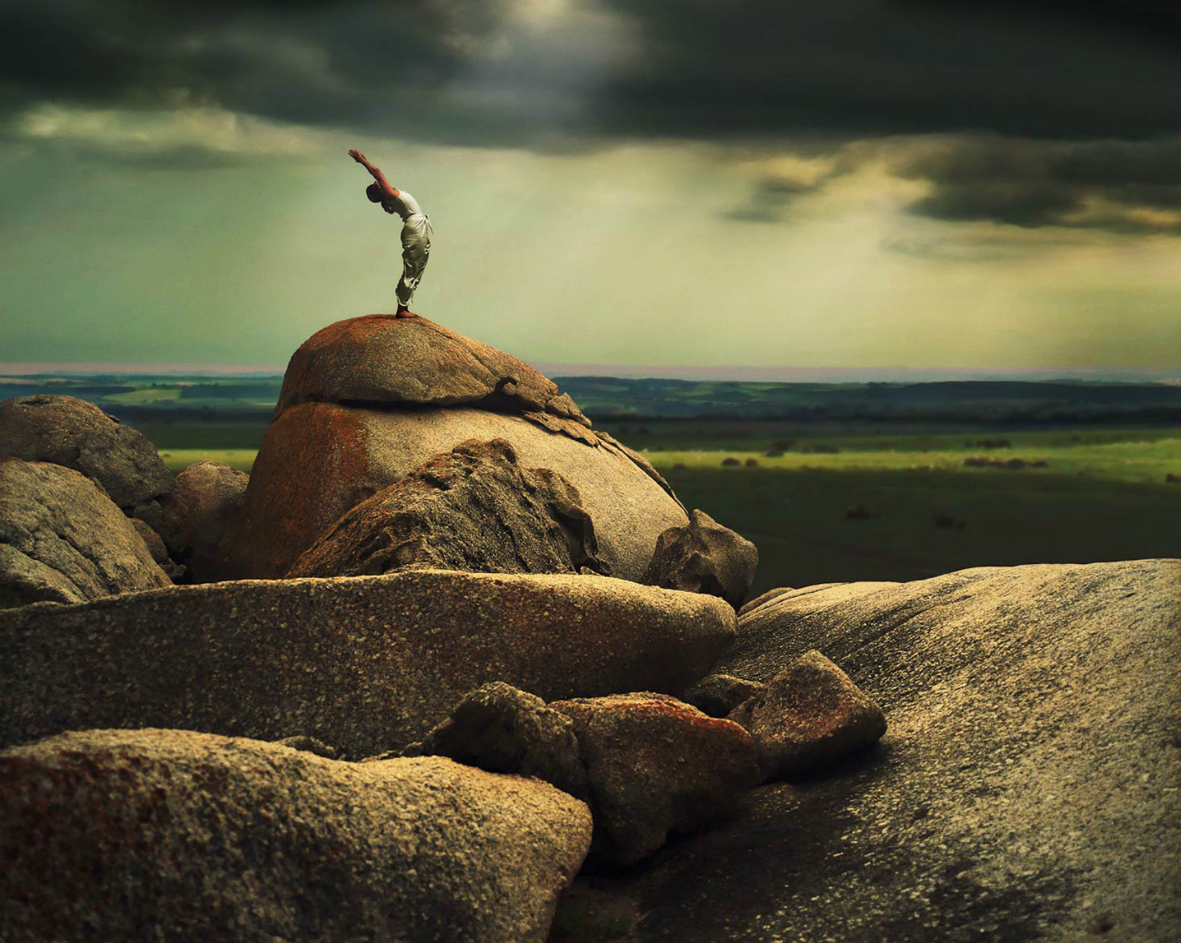 Woman practicing Yoga on Rock. Capetown South Africa