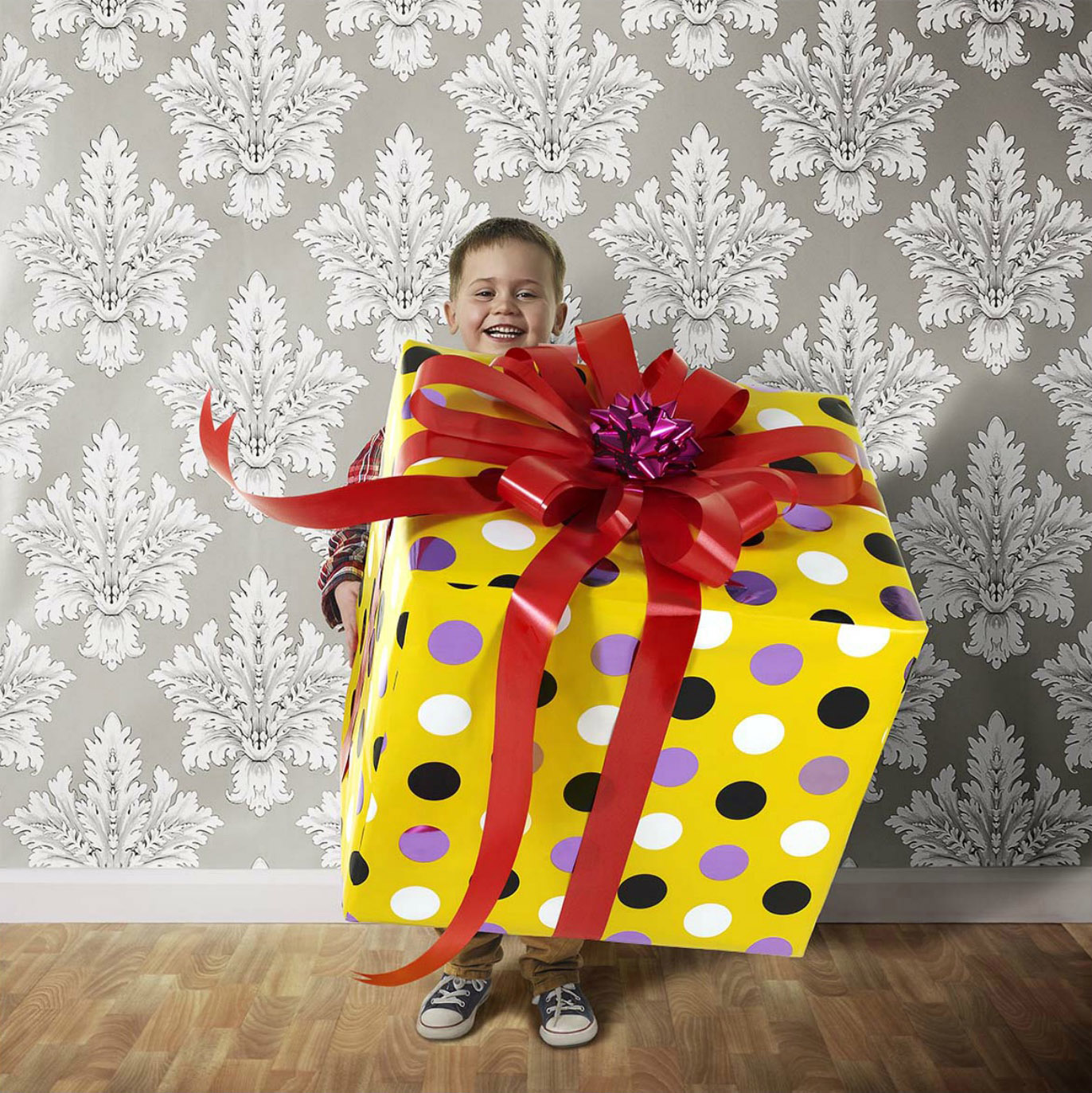 Boy Holding Great Big Gift